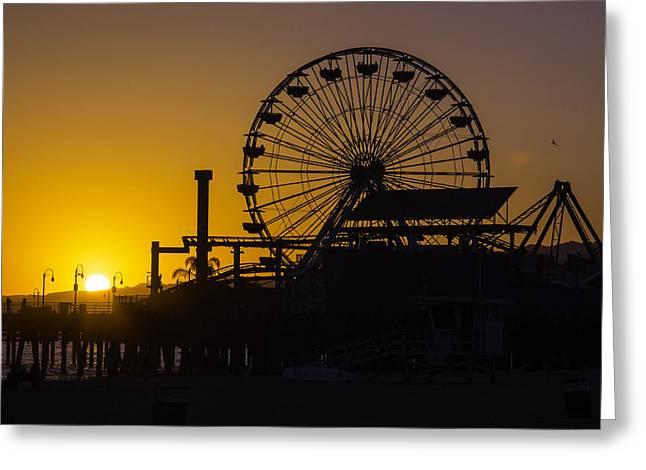 Ferris Wheels Greeting Cards - Sun Setting Beyond Ferris Wheel Greeting Card by Garry Gay