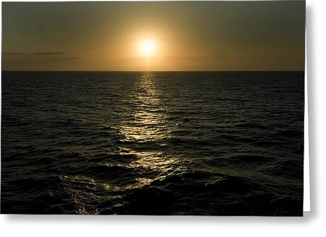 Sun Setting Over Caribbean Sea Greeting Card by Todd Gipstein