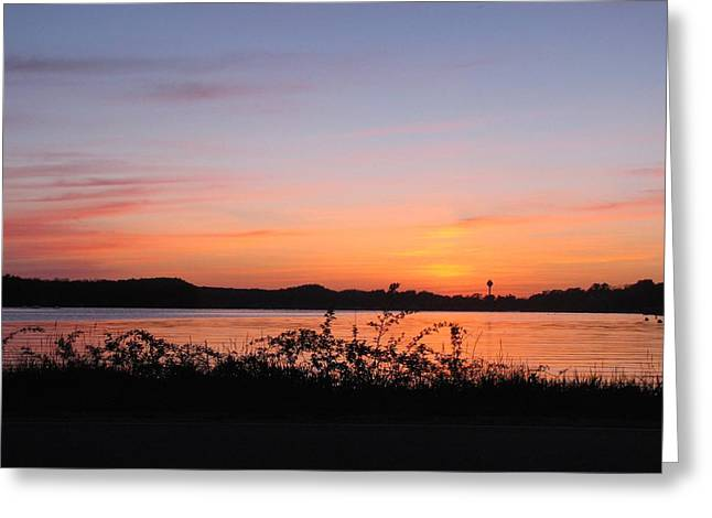 Reflections Of Sky In Water Greeting Cards - Sunset Over Pentwater Lake Greeting Card by Jane Greiner