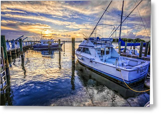 Ocean Shore Greeting Cards - Sunset over the Docks Greeting Card by Debra and Dave Vanderlaan