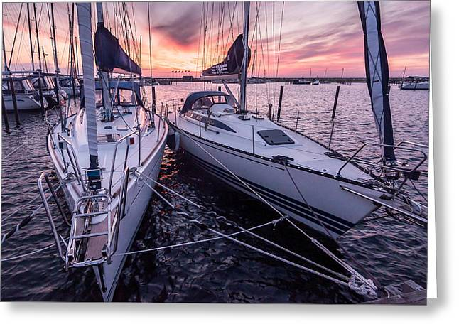 Yellow Sailboats Greeting Cards - Sunset Sailboats Greeting Card by Marcus Karlsson Sall