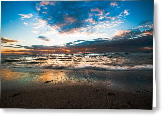 Reflection Of Sun In Clouds Greeting Cards - Sunset sky reflected in wet sand Greeting Card by Gene Camarco