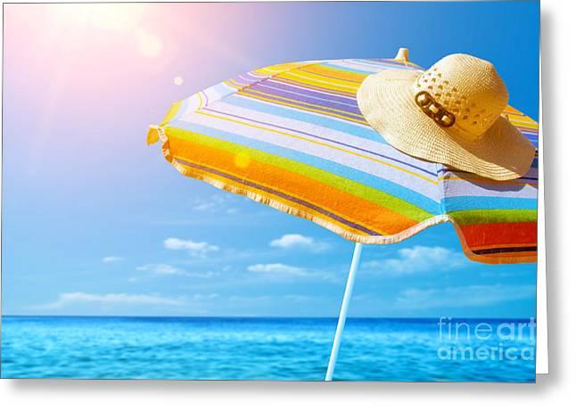 Sunbathing Greeting Cards - Sunshade and Hat Greeting Card by Carlos Caetano
