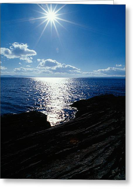 Sunstar Over Yellowstone Lake Greeting Card by Panoramic Images