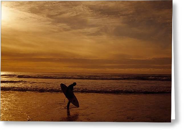 Surfer Ocean Beach Carmel Ca Greeting Card by Panoramic Images