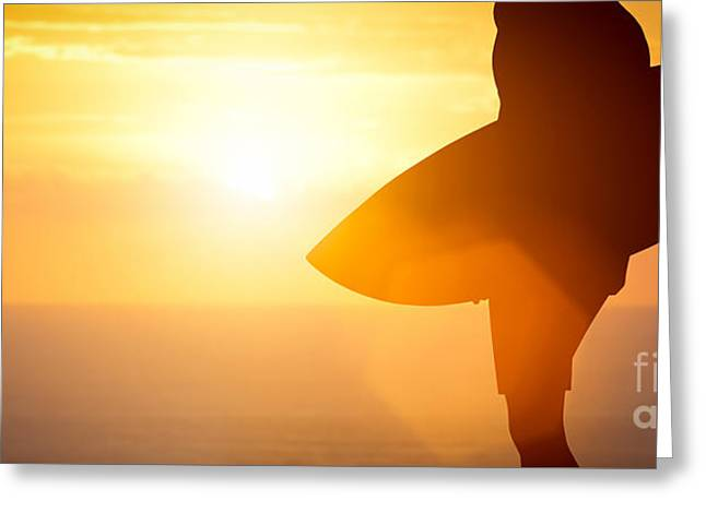 Surfer Standing With His Surfboard On The Beach At Sunset Over The Ocean Greeting Card by Michal Bednarek