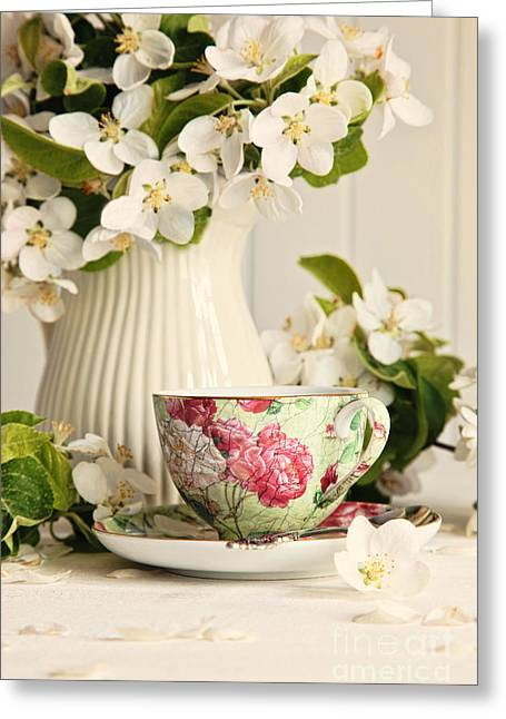 White China Cup Greeting Cards - Tea cup with fresh flower blossoms Greeting Card by Sandra Cunningham