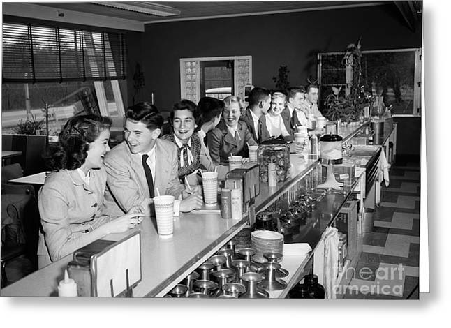Teens At Soda Fountain Counter, C.1950s Greeting Card by H. Armstrong Roberts/ClassicStock