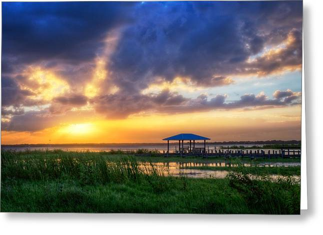 The Boathouse At Sunset Greeting Card by Debra and Dave Vanderlaan