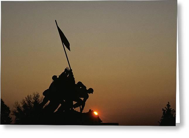 The Iwo Jima Memorial Silhouetted Greeting Card by Kenneth Garrett