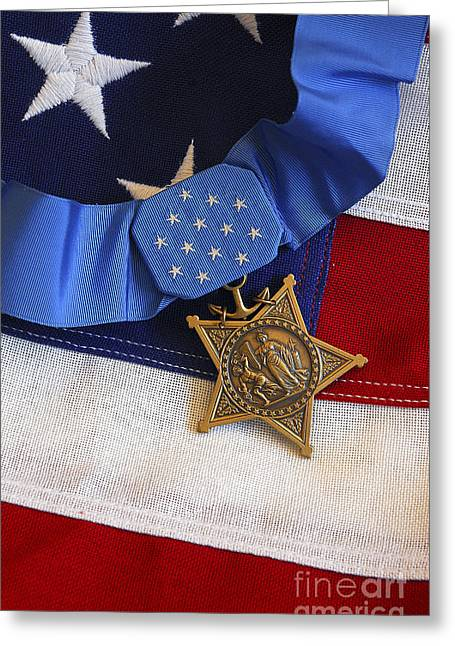 Award Greeting Cards - The Medal Of Honor Rests On A Flag Greeting Card by Stocktrek Images