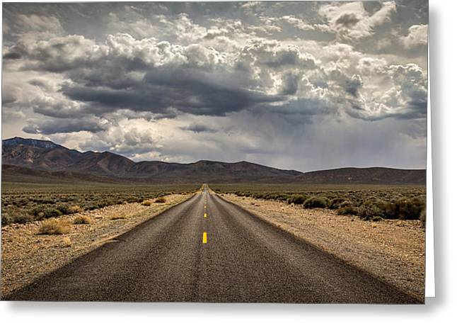 Puffy Clouds Greeting Cards - The Road to Death Valley Greeting Card by Peter Tellone