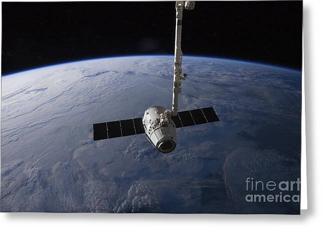 Astronautics Greeting Cards - The Spacex Dragon Cargo Craft Greeting Card by Stocktrek Images
