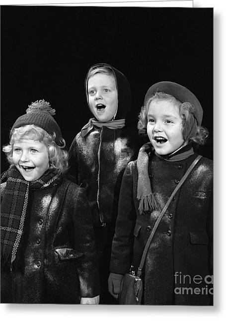 Harmonize Greeting Cards - Three Children Caroling, C.1940s Greeting Card by H. Armstrong Roberts/ClassicStock