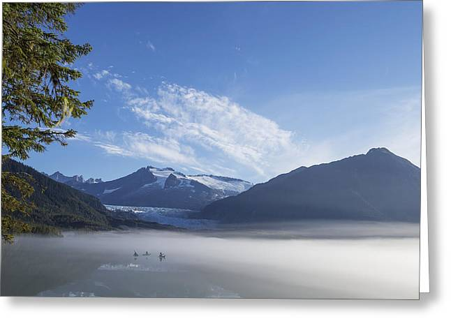 Mid Summer Morning Greeting Cards - Three Kayakers Paddle The Shoreline Greeting Card by John Hyde