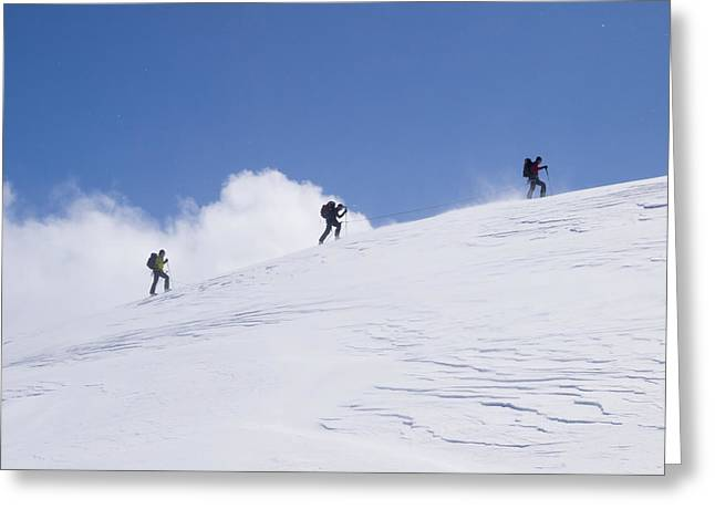 Swiss Culture Greeting Cards - Three Ski Tourists Walking Greeting Card by Penny Kendall