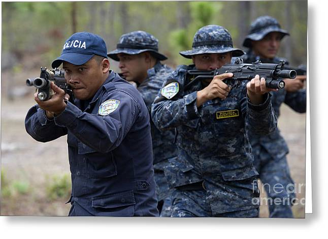 Military Police Greeting Cards - Tigres Commandos Conduct Bounding Greeting Card by Stocktrek Images