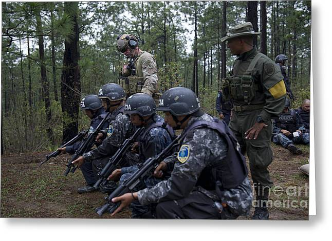 Military Police Greeting Cards - Tigres Commandos Wait To Conduct Greeting Card by Stocktrek Images