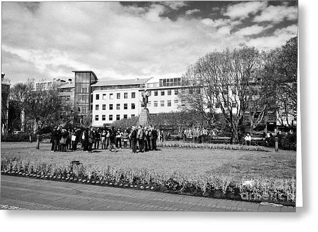 Meeting. Point Greeting Cards - tourists on walking tour in austurvollur public square Reykjavik iceland Greeting Card by Joe Fox