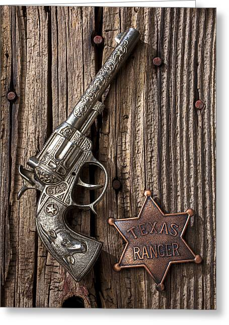 Plaything Greeting Cards - Toy gun and ranger badge Greeting Card by Garry Gay