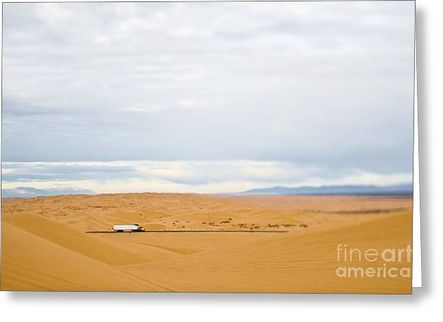 Calif Greeting Cards - Truck Driving Through Desert Greeting Card by Eddy Joaquim