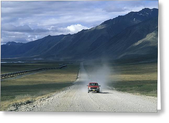 Truck On The Dalton Highway Following Greeting Card by Rich Reid