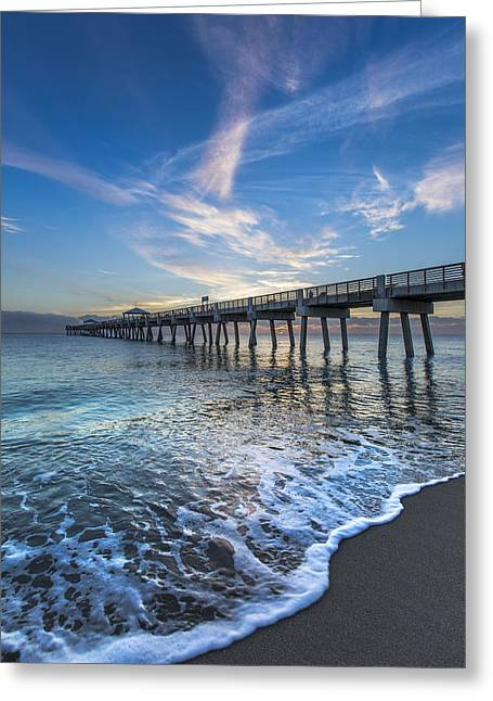Turquoise Seas At The Pier Greeting Card by Debra and Dave Vanderlaan