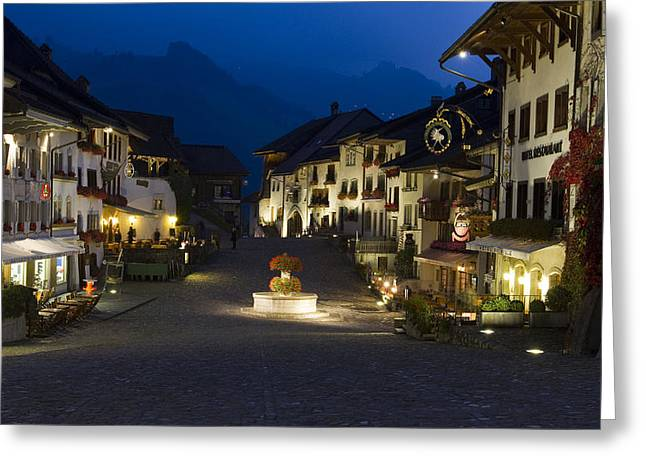Gruyere Greeting Cards - Twilight in the mountain village of Gruyeres Greeting Card by Kalpana Geisenheyner
