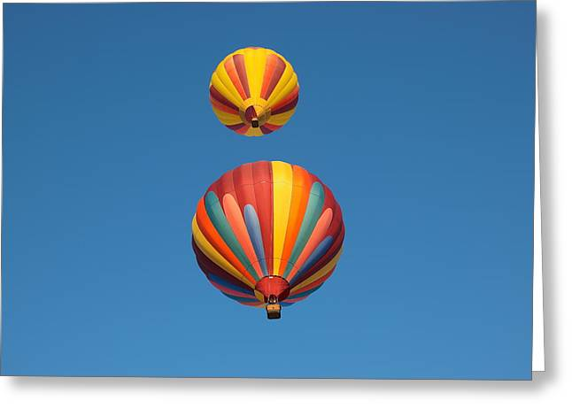 Two Balloons Passing Over Greeting Card by Jeff Swan