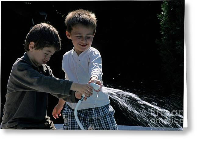 Children Only Greeting Cards - Two boys playing with garden hose Greeting Card by Sami Sarkis