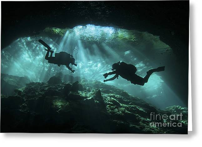 Technical Photographs Greeting Cards - Two Divers Silhouetted In Light Greeting Card by Karen Doody