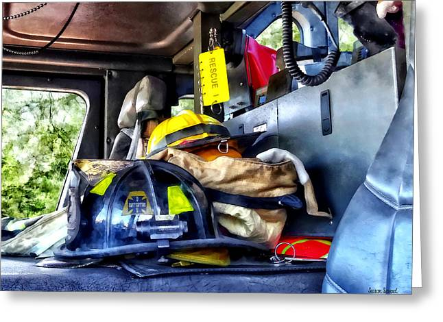 Two Firefighter's Helmets Inside Fire Truck Greeting Card by Susan Savad