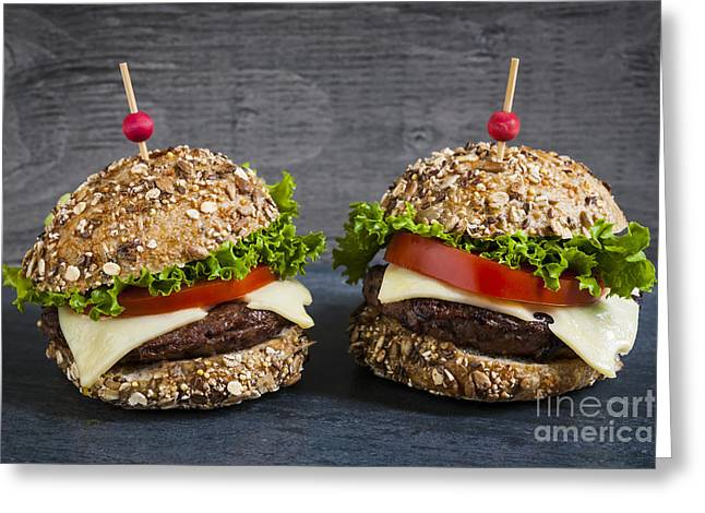 Blue Cheese Greeting Cards - Two gourmet hamburgers Greeting Card by Elena Elisseeva