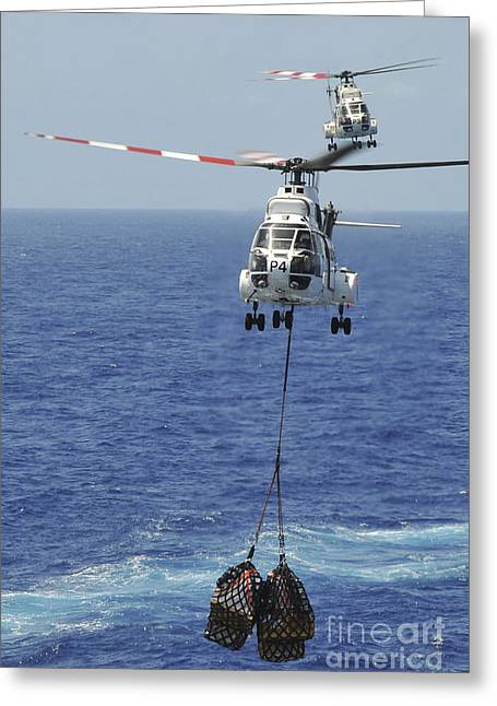 Carrier Greeting Cards - Two Sa-330 Puma Helicopters Deliver Greeting Card by Stocktrek Images