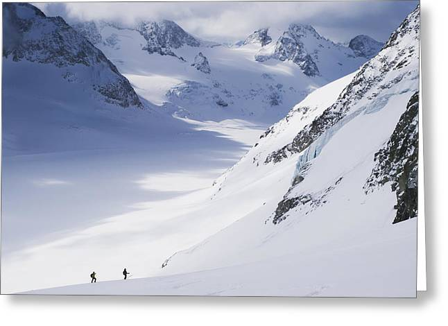 Swiss Culture Greeting Cards - Two Skiers In Big Glacial Landscape Greeting Card by Penny Kendall