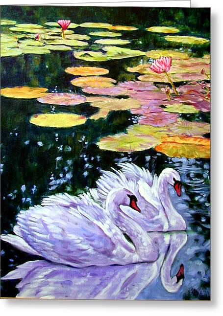 Two Swans In The Lilies Greeting Card by John Lautermilch
