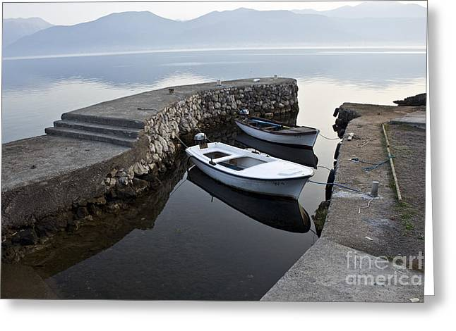 Two Wooden Boats In A Little Bay In The Morning Greeting Card by Dan Radi