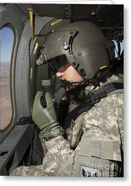Looking Out Side Greeting Cards - Uh-60 Black Hawk Crew Chief Looking Greeting Card by Terry Moore