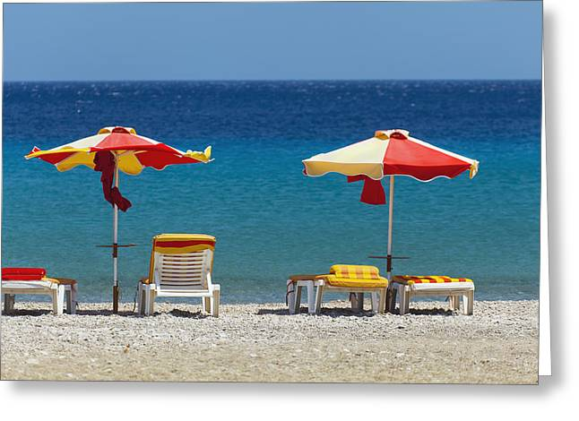 Umbrellas And Beach Chairs On A Beach Greeting Card by Terence Waeland
