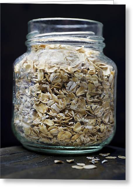 Oatmeal Greeting Cards - Uncooked Oatmeal Flakes Greeting Card by Donald  Erickson