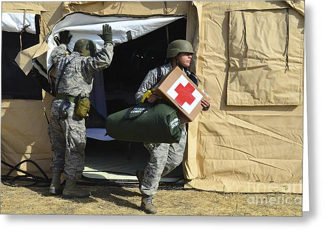 Medic Greeting Cards - U.s. Air Force Soldier Exits A Medical Greeting Card by Stocktrek Images