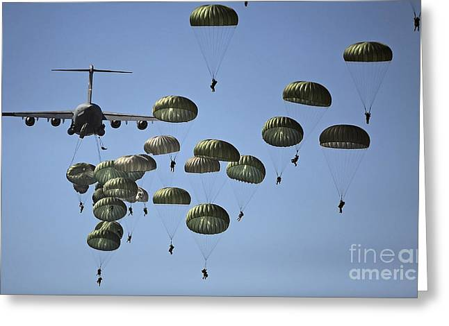Troops Photographs Greeting Cards - U.s. Army Paratroopers Jumping Greeting Card by Stocktrek Images