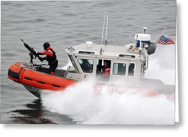 Law Enforcement Greeting Cards - U.s. Coast Guardsmen Aboard A Security Greeting Card by Stocktrek Images