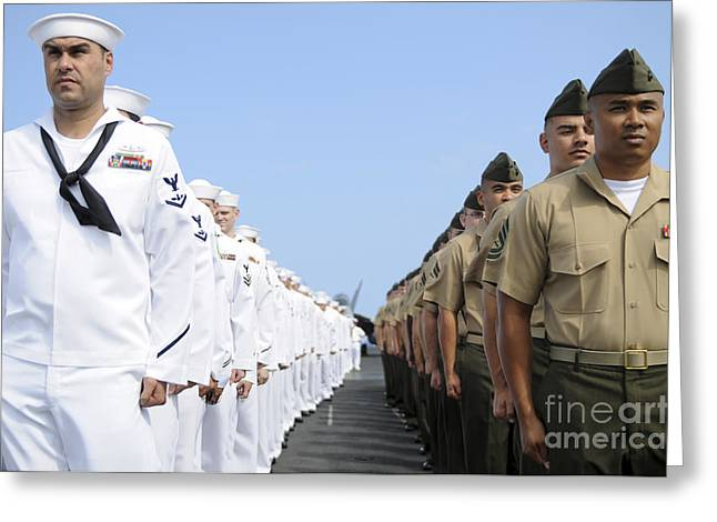 Squinting Greeting Cards - U.s. Marines And Sailors Stand Greeting Card by Stocktrek Images