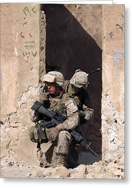 Combat Uniforms Greeting Cards - U.s. Marines Taking Cover In An Greeting Card by Stocktrek Images