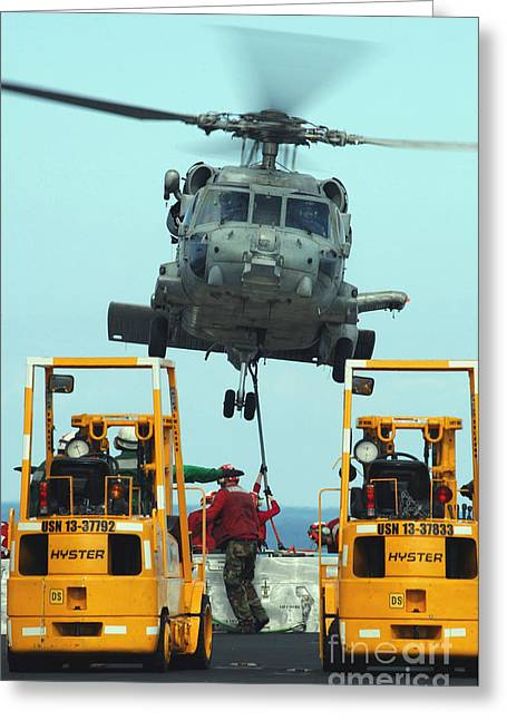 Hovering Greeting Cards - U.s. Navy Sailors Attach A Sling Greeting Card by Stocktrek Images