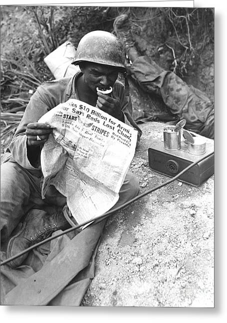 Battleground Greeting Cards - U.s. Soldier Reads The Latest News Greeting Card by Stocktrek Images
