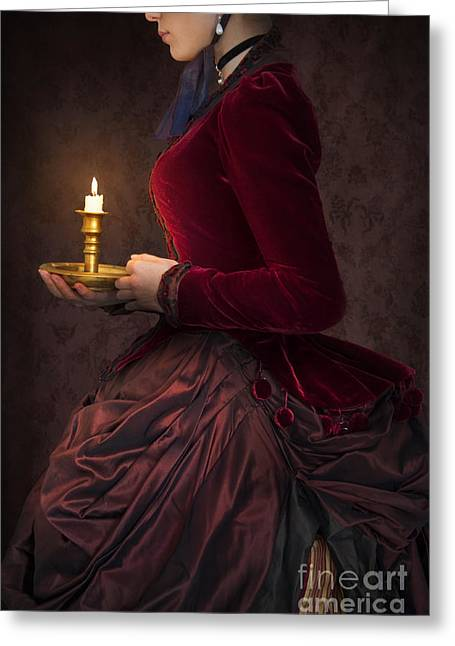 Satin Skirt Greeting Cards - Victorian Woman In A Red Bussle Dress Holding A Candle At Night Greeting Card by Lee Avison