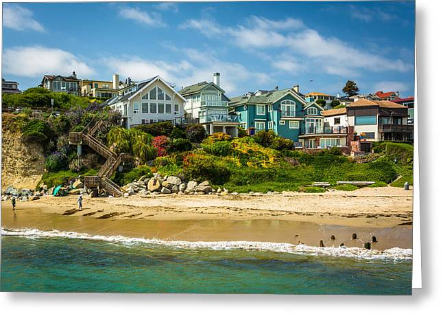 Santa Cruz Wharf Greeting Cards - View of houses on bluffs above the beach in Capitola California Greeting Card by Jon Bilous