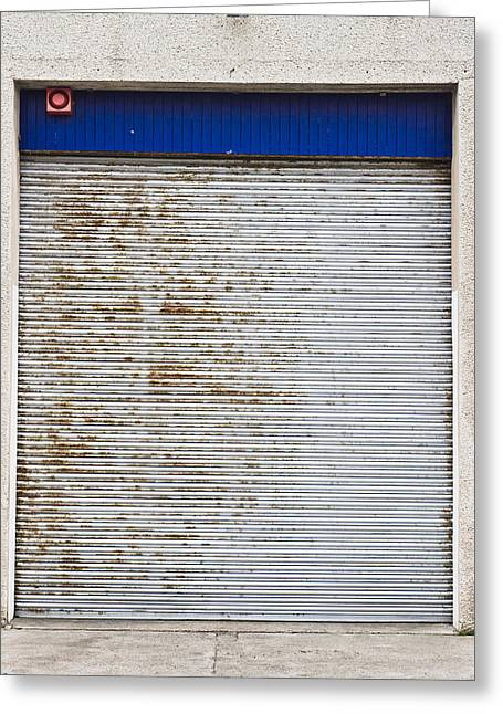 Warehouse Door Greeting Card by Tom Gowanlock